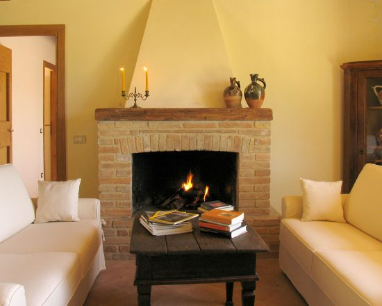 True-Umbria-Villa-Cipresso-Living-with-open-Fireplace
